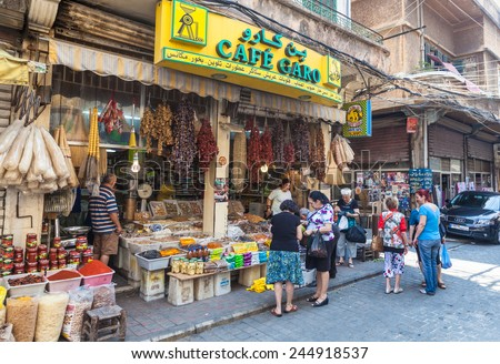 BEIRUT, LEBANON - JUNE 17, 2013: An unidentified locals buying food on a street. Life in Beirut is coming back to normal after Lebanon war in 2006. - stock photo