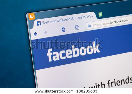 BELCHATOW, POLAND - APRIL 11, 2014: Photo of Facebook social network homepage on a monitor screen. - stock photo