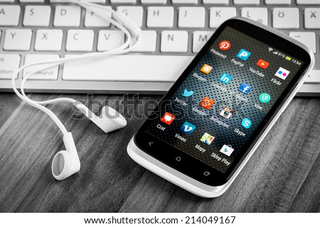 BELCHATOW, POLAND - APRIL 06, 2014: Social media icons on smart phone screen - stock photo