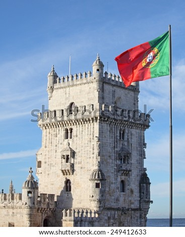 Belem Tower in Lisbon and Portuguese national flag - stock photo