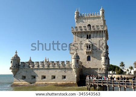 Belem Tower on the Tagus river in Lisbon (Portugal) was a part of a defense system at the mouth of the Tagus river and a ceremonial gateway to Lisbon. The tower was built in the early 16th century. - stock photo