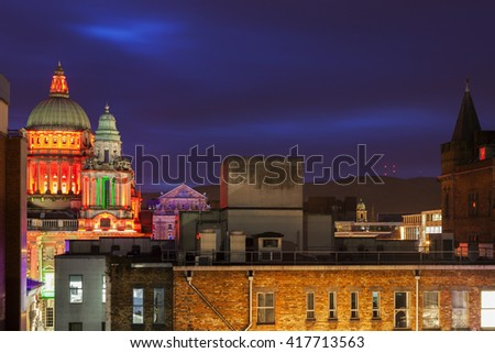 Belfast architecture with illuminated City Hall and Mt. Divis. Belfast, Northern Ireland, United Kingdom. - stock photo