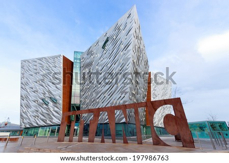 BELFAST, NORTHERN IRELAND - FEB 9, 2014: The Titanic visitor attraction and a monument in Belfast, Northern Ireland. Opened in 2012, this is the Titanic sign in front of the entrance.  - stock photo