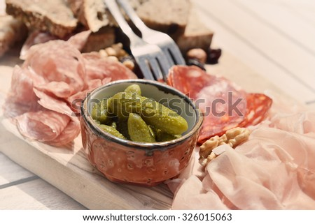 Belgian delicatessen on a wooden desk in sunny day closeup photo with vintage effects - stock photo