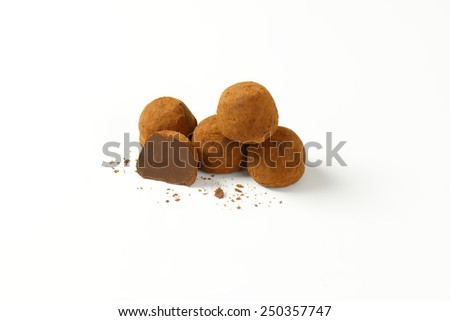 belgian pralines with chocolate butter on white background - stock photo