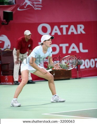 Belgian tennis star Justine Henin in action against Alicia Molik at the Qatar Total Open, Doha, February 28, 2007, which Henin won. - stock photo