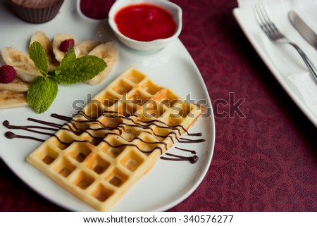 Belgian wafers with hot chocolate and strawberry sauce - stock photo