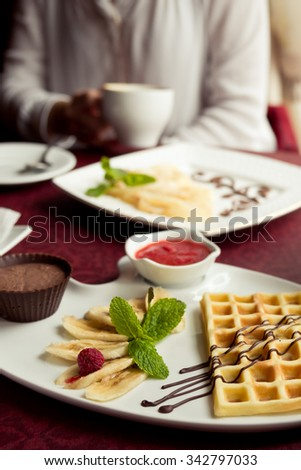 Belgian wafers with hot chocolate, strawberry sauce and ice cream - stock photo
