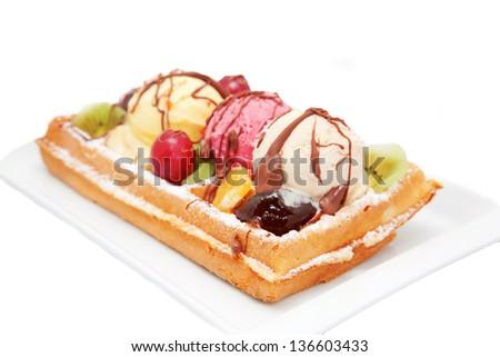 Belgian waffle with fruit, ice cream, chocolate. Isolated on white background - stock photo