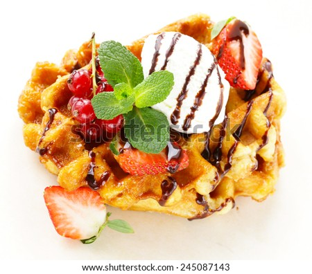 Belgian waffles with berries (currants, strawberries) and ice cream - stock photo