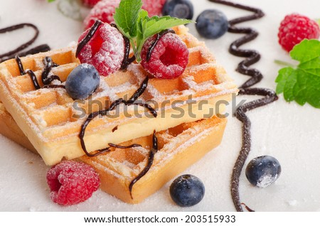 Belgian waffles with  fresh berries. Selective focus - stock photo