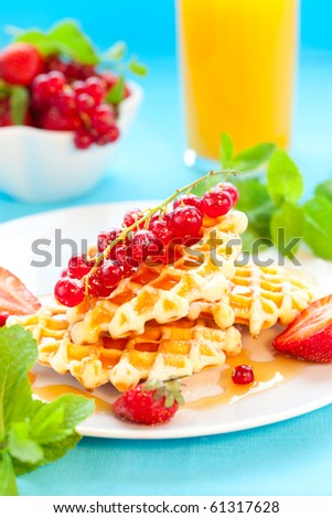 Belgian waffles with honey and berries - stock photo