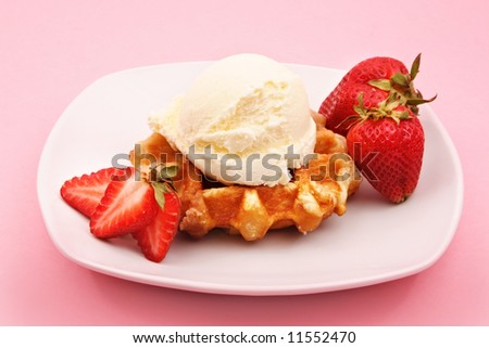 Belgian waffles with strawberries and ice cream - stock photo
