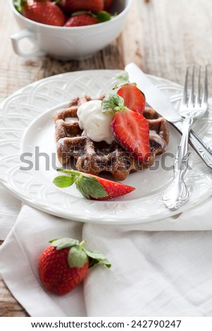 Belgian waffles with vanilla ice cream and strawberries - stock photo