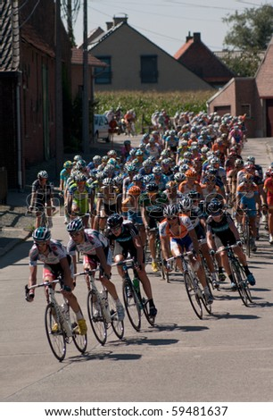 "BELGIUM - AUGUST 20: Cycling race ""Eneco Tour"" on August 20, 2010 in Lierde, Belgium - stock photo"