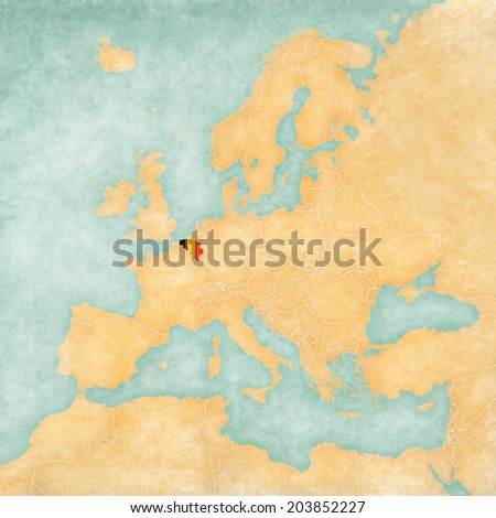 Belgium (Belgian flag) on the map of Europe. The Map is in vintage summer style and sunny mood. The map has a soft grunge and vintage atmosphere, which acts as watercolor painting on old paper.  - stock photo