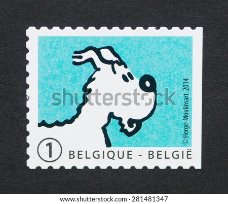 BELGIUM - CIRCA 2014: A postage stamp printed in Belgium showing an image of the dog Snowy or Milou a Tintin cartoon character, circa 2014.  - stock photo
