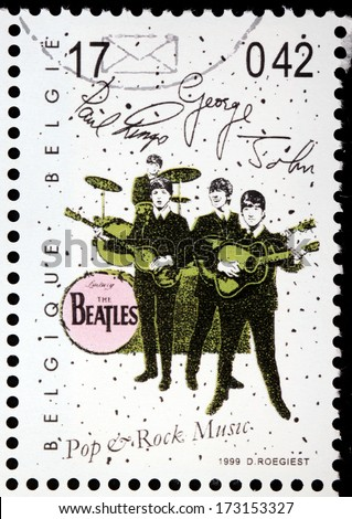 BELGIUM - CIRCA 1999: a stamp printed by BELGIUM shows famous British rock band The Beatles, circa 1999 - stock photo
