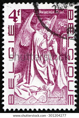 BELGIUM - CIRCA 1974: a stamp printed in the Belgium shows Angel from the Triptyque The Mystical Lamb in the Saint-Bavon Cathedral, Ghent, by Van Eyck Brothers, Christmas, circa 1974 - stock photo