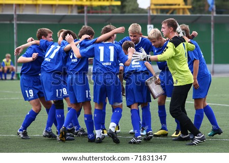 BELGOROD, RUSSIA - AUGUST 20: Unidentified boys embrace before football game on August, 20 2010 in Belgorod, Russia. The final of Chernozemje superiority, Football kinder team of 1996 year of birth. - stock photo
