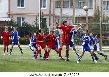 BELGOROD, RUSSIA - AUGUST 21: Unidentified boys plays football on August, 21 2010 in Belgorod, Russia. The final of Chernozemje superiority, Football kinder team of 1996 year of birth. - stock photo