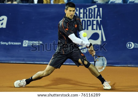 "BELGRADE - APRIL 27: Novak Djokovic seen during the ""Serbia Open"" tennis match against Adrian Ungur in Belgrade April 27, 2011 in Belgrade, Serbia. - stock photo"