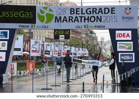 "BELGRADE-APRIL 18:""28th Belgrade Marathon"".Finish of marathon forwo man.Winner is Adugna Abebu Gelan (ETH) with time:2 hour 33min 12sec.On April 18, 2015 in Belgrade, Serbia  - stock photo"