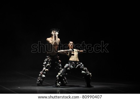 """BELGRADE - APRIL 12: Unidentified Dutch artists from the Scapino Ballet group dance in a piece titled """"Bravo Charlie"""" during the Belgrade Dance Festival on April 12, 2011 in Belgrade, Serbia. The dance is choreographed by Marco Goecke. - stock photo"""