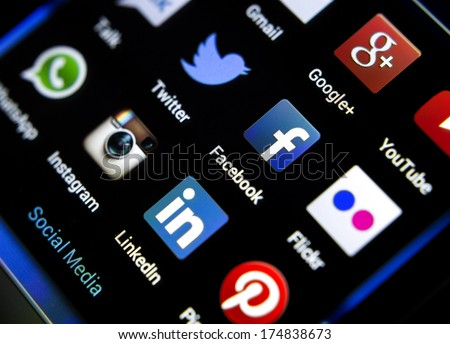 BELGRADE - FEBRUARY 04, 2014: Popular social media icons on smart phone screen - stock photo