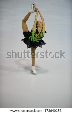 "BELGRADE - JANUARY 25: Finland's Juulia Turkkila performs free skating at Europa Cup figure ice skating competition ""Skate Helena"" in Belgrade, Serbia on January 25, 2014 - stock photo"
