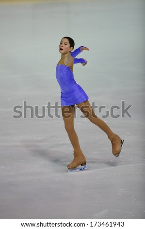"BELGRADE - JANUARY 23: Slovenia's Kaja Gril performs her free skating program at Europa Cup figure skating competition ""Skate Helena"" in Belgrade, Serbia on January 23, 2014 - stock photo"