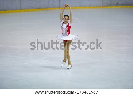 "BELGRADE - JANUARY 23: Slovenia's Masa Doler performs her free skating program at  Europa Cup figure ice skating competition ""Skate Helena"" in Belgrade, Serbia on January 23, 2014 - stock photo"