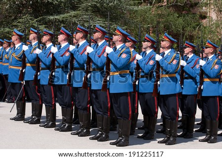 BELGRADE - May 6:Serbian army guards salutes the flag on Celebration of the Serbian Army Guard,MAY 6,2014 in BELGRADE, SERBIA - stock photo