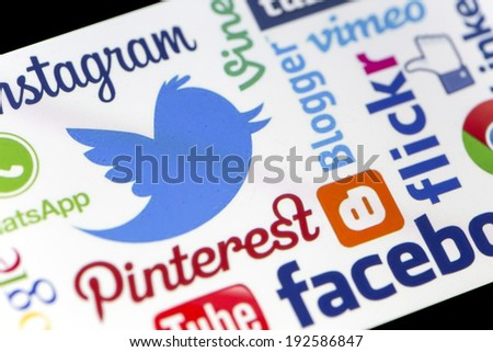 BELGRADE - MAY 13, 2014 Twitter and other popular social media website logos on smart phone screen - stock photo