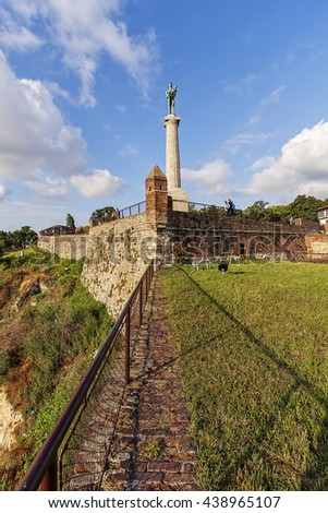 Belgrade medieval walls of fortress and victor monument in day time, Serbia - stock photo