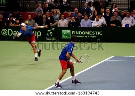 BELGRADE-NOVEMBER 16:Player T.Berdych (CZE) run for a ball during a match against Serbia (SRB) in final Davis Cup Serbia-Czech.Czech Republic won 3:0,on November 16,2013 in Belgrade,Serbia  - stock photo