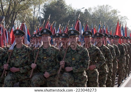 BELGRADE-OCTOBER12:Echelon of Serbian Army war flags practiced ceremonial step.On preparations for the parade Serbian Army.On October 12,2014 in Belgrade,Serbia  - stock photo