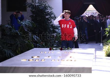 BELGRADE - OCTOBER 26: Man on the grave of Josif Broz Tito during funeral of Jovanka Broz former Yugoslavia's first lady in Belgrade, Serbia, October 26, 2013 - stock photo