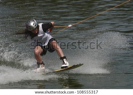 "BELGRADE - SEPTEMBER 4: Chloe Goudie rides wakeboard during ""13 cable wakeboard european championship"" September 4, 2011 in Belgrade, Serbia. - stock photo"