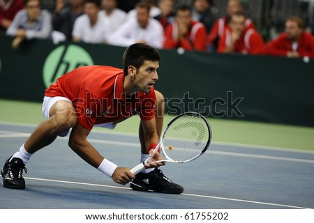 BELGRADE - SEPTEMBER 18: Novak Djokovic seen at Davis Cup Semifinals which he play with Nenad Zimonjic against Tomas Berdych and Radek Stepanek in Belgrade September 18, 2010 in Belgrade, Serbia. - stock photo