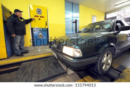 BELGRADE, SERBIA - CIRCA NOVEMBER 2011: Worker inspects vehicle at technical inspection of vehicles center, circa November 2011 in Belgrade - stock photo