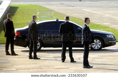 BELGRADE, SERBIA - CIRCA OCTOBER 2014: Security officers protects car with VIP person, circa October 2014 in Belgrade - stock photo