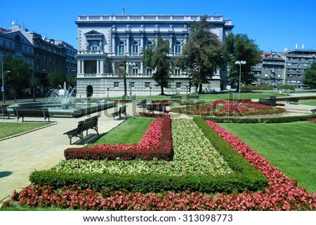 Belgrade, Serbia - famous Old Palace and flower gardens in the city. Currently local government headquarters - City Assembly. Filtered style colors. - stock photo