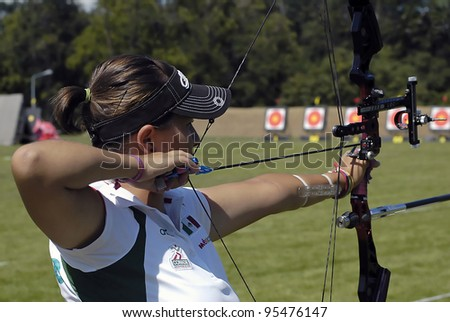 "BELGRADE,SERBIA - JULY 10: An unidentified female archer is ready to participate in the compound bow competition of the ""25th University Games"" on July 10, 2009 in Belgrade, Serbia - stock photo"