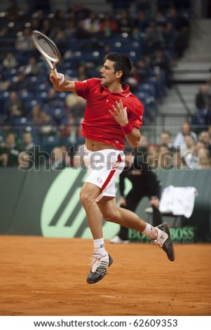 BELGRADE, SERBIA - MARCH 7: Novak Djokovic plays against John Isner in the Davis Cup 2010 on March 7, 2010 in Belgrade, Serbia. - stock photo