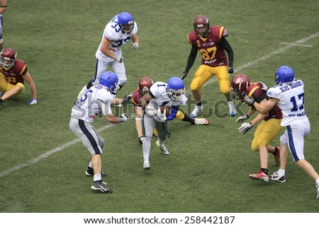 Belgrade, Serbia - May 05, 2014: Team Blue Dragons in action. American Football Match Between Belgrade Wolves And Blue Dragon in Belgrade. The Wolves team is winner. - stock photo