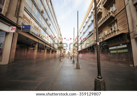 Belgrade, Serbia - 11. November 2015.,Main street Knez Mihailova in Belgrade, Serbia during the autumn day and with long exposure Neutral Density filter used, no recognizable people  - stock photo