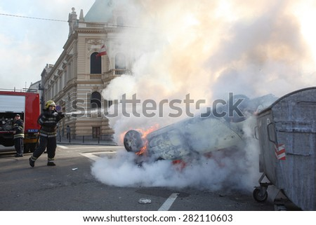 Belgrade, Serbia - October 10, 2010: a fireman put out a fire during the gay pride parade - stock photo