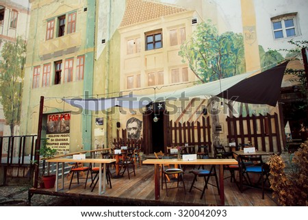 BELGRADE, SERBIA - SEP 13: Murals on the empty old cafe walls of the famous vintage street Skadarlija on September 13, 2015. Tourism in Serbia employs 75,000 people, about 3% of country's workers - stock photo