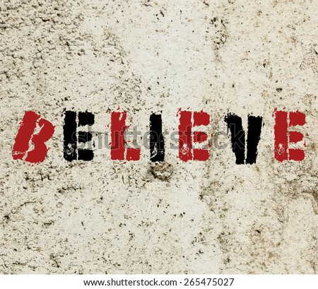 Believe graffiti painted on a concrete wall   - stock photo